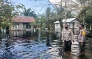 Polsek Serhil Cek Debit Air di Desa Tanggul Harapan