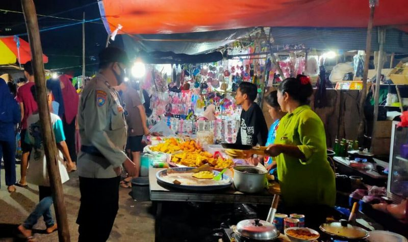 Cegah Covid-19, Polsek Danau Sembuluh Sosialisasi Prokes di Pasar Malam