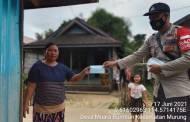 Bhabinkamtibmas Ini Keliling Desa Ingatkan Kepatuhan Prokes Covid-19