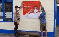 Pasang Spanduk Presiden RI di Pelabuhan untuk Ingatkan Warga Wajib Masker